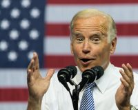 Joe Biden Posts Odd Pic With A Toddler… Twitter Responds!